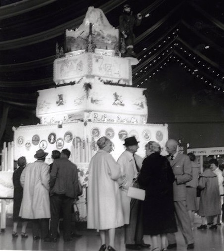 "Werner Lenggenhager photograph of what was billed as the ""World's largest cake,"" in the Food Circus of Century 21 Exposition (Seattle World's Fair)"